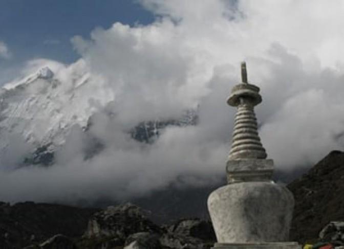 Buddhist Stupa and Langtnag mountain range including Langtang Lirung(7246m) in Langtang