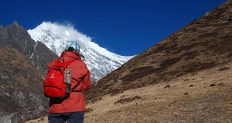 The trekker is looking a mountain Langtang lirung