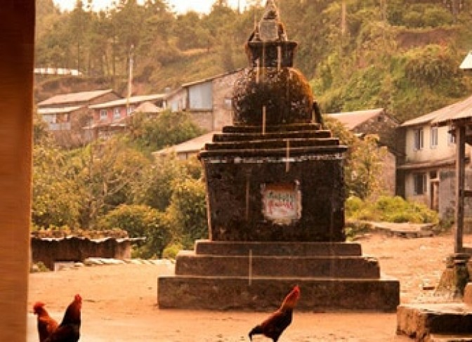 Traditional village, small Buddhist stupa and chicken in Langtang helambu trekking