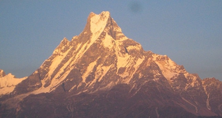 Machhapuchchhre (6,993 m /22,943 ft) sacred to the god Shiva, and hence is off limits to climbing is a mountain in the Annapurna Himalayas of north central Nepal.