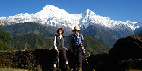 Annapurna south (7219m) and Himchuli (6446m) trekkers are taking photos