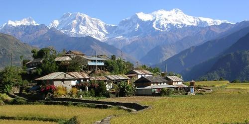 Local village, fertile land and Annapurna Mountains
