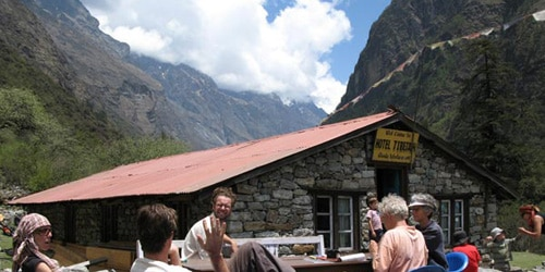 The trekkers are having Lunch at Ghodatabela(3020m/9905ft) with beautiful Langtang valley scenario