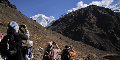 The trekkers are taking photos in Annapurna region