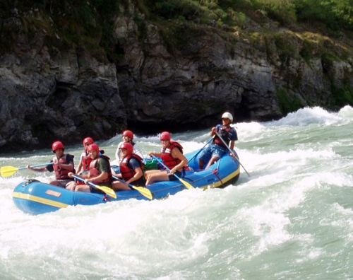 Nepal Adventure Tour - Trishuli river rafting is fun challenging with a good mixture of continuous rapids and pleasant calm water