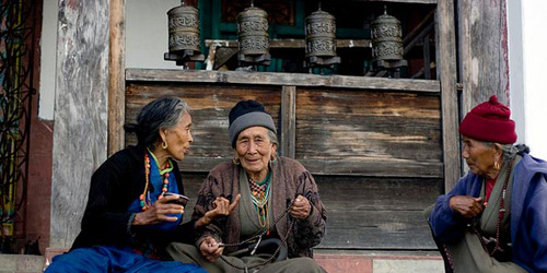 Old local Buddhist women are taking each other